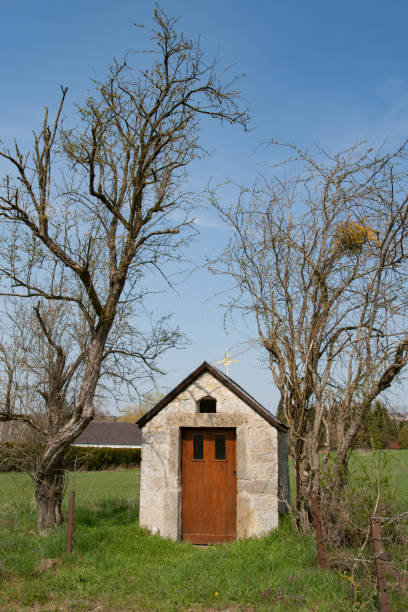 Small chapel between two trees stock photo