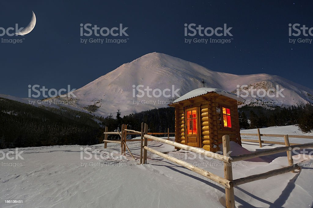 Small chapel in the mountains at winter. royalty-free stock photo