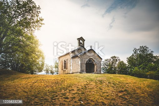istock Small chapel of Notre Dame de l'Etoile on Dent du Chat mountain near Bourget lake in Savoie in french Alps mountains 1225833236