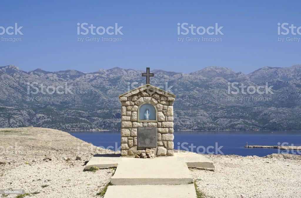 Small chapel with Mary statue on the Island of Pag Dalmatia, Croatia stock photo