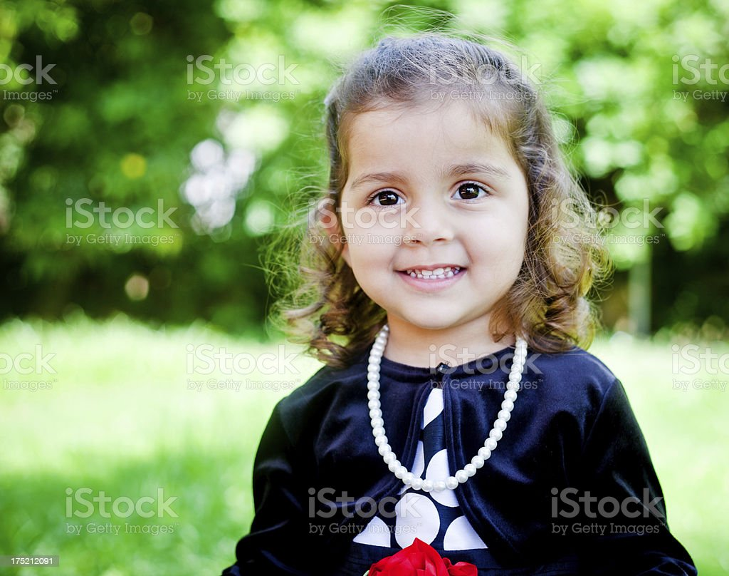 small cheerful indian baby girl outdoor portrait stock photo & more