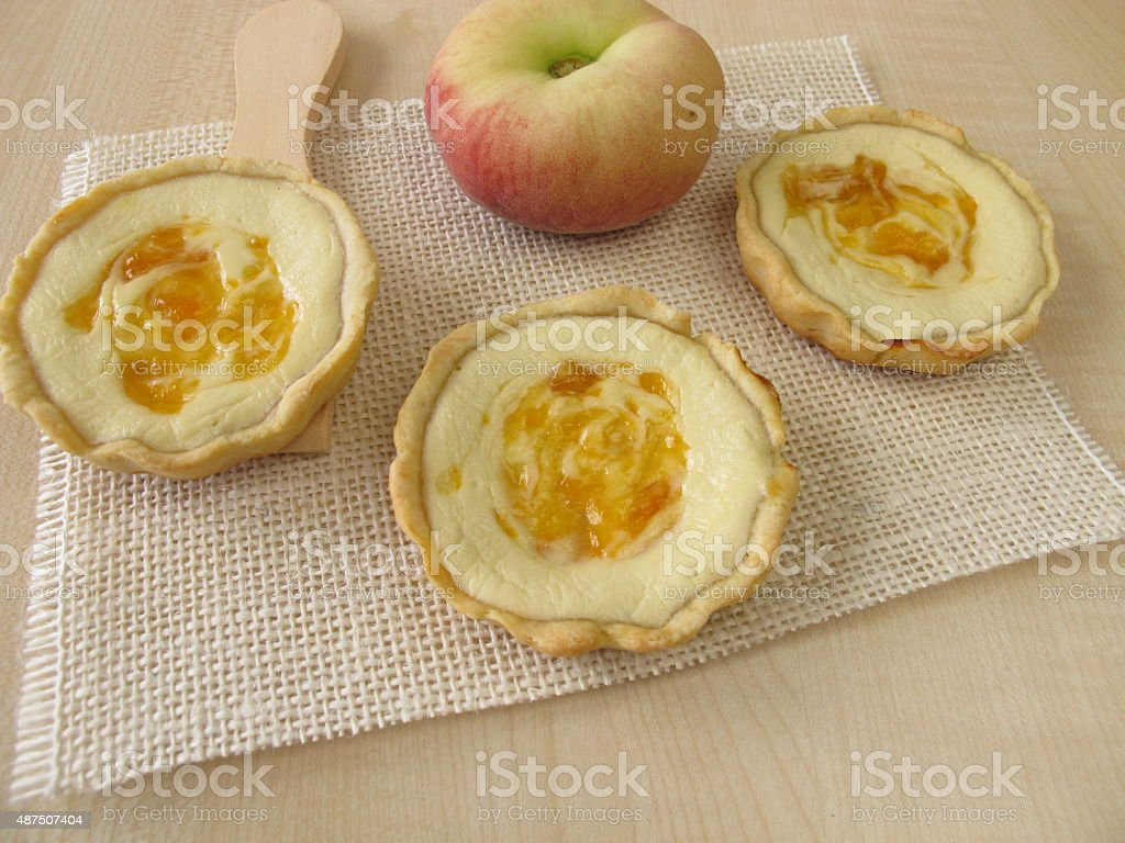 Small cheesecake with peach stock photo