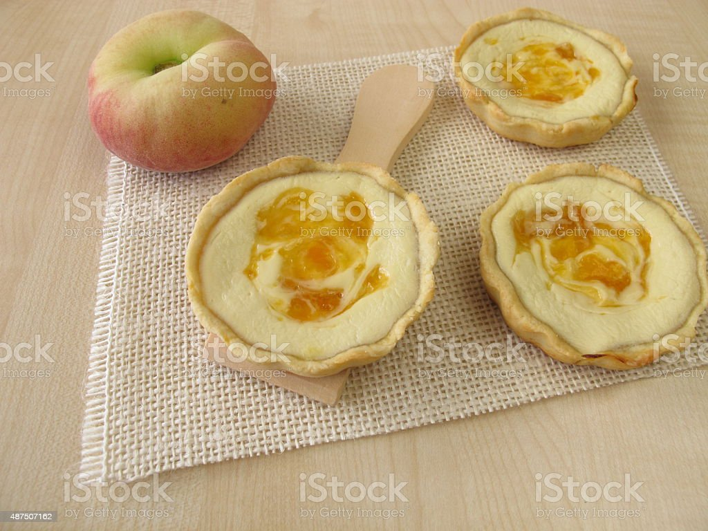 Small cheesecakes with peach stock photo