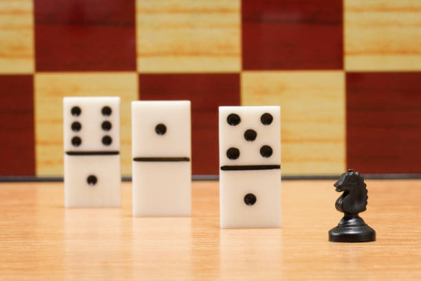 small chess horse and dice for playing dominoes stock photo