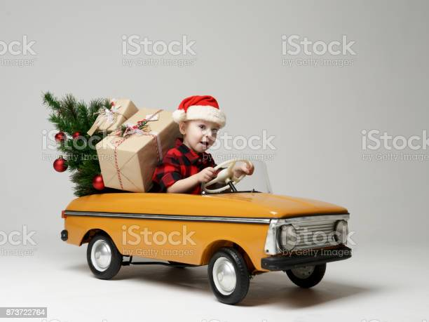 Small child boy in winter sitting in a yellow retro toy car pulls on picture id873722764?b=1&k=6&m=873722764&s=612x612&h=gl6n5u8kmyqnqn3bauzzhggq5teozhafwbzou5y1w7i=