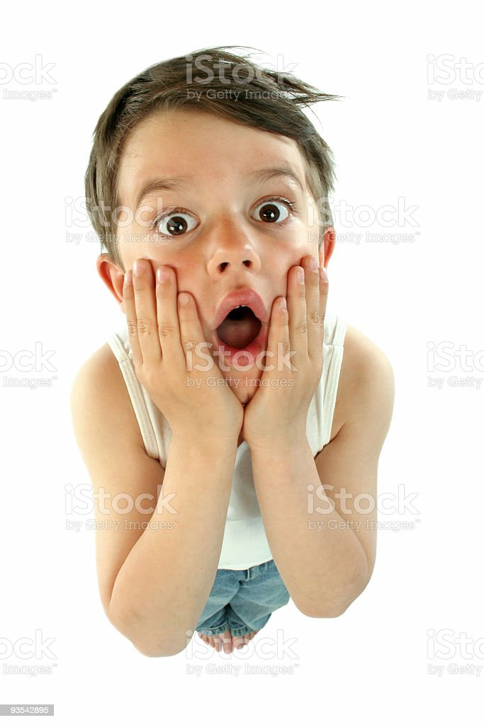 A small child cupping his face in utter shock royalty-free stock photo