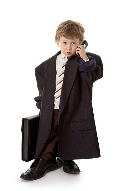 kleines kind angezogen wie geschäftsmann - kleinkind busy bags stock-fotos und bilder
