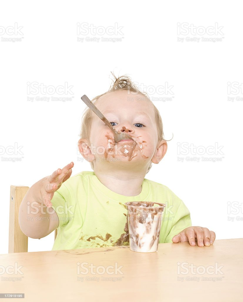 small child eating yoghurt royalty-free stock photo