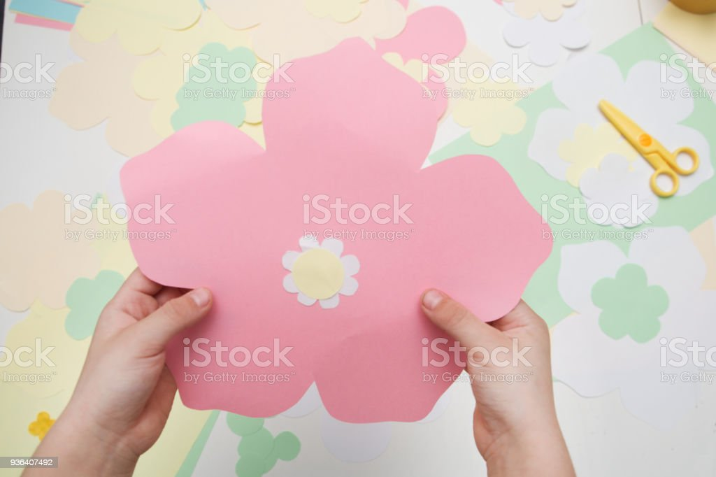 Small Child Holds A Felt Paper Flower Ornament In His Hands Festive Spring Crafts Concept Childrens Creativity The Child Does A Decor For Easter Holiday Stock Photo Download Image Now Istock