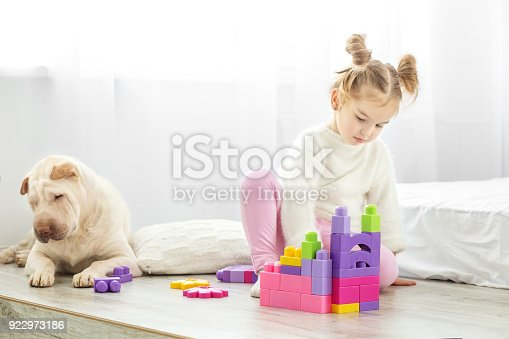 istock A small child is playing plastic toys in blocks in the room. The 922973186