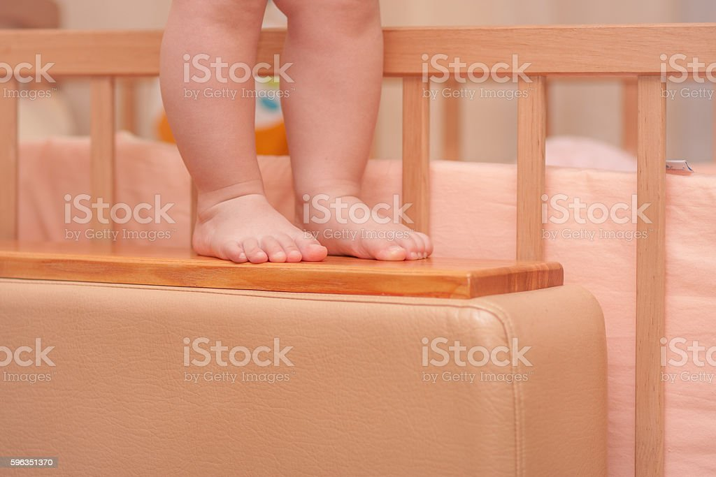 small child legs near the cot royalty-free stock photo