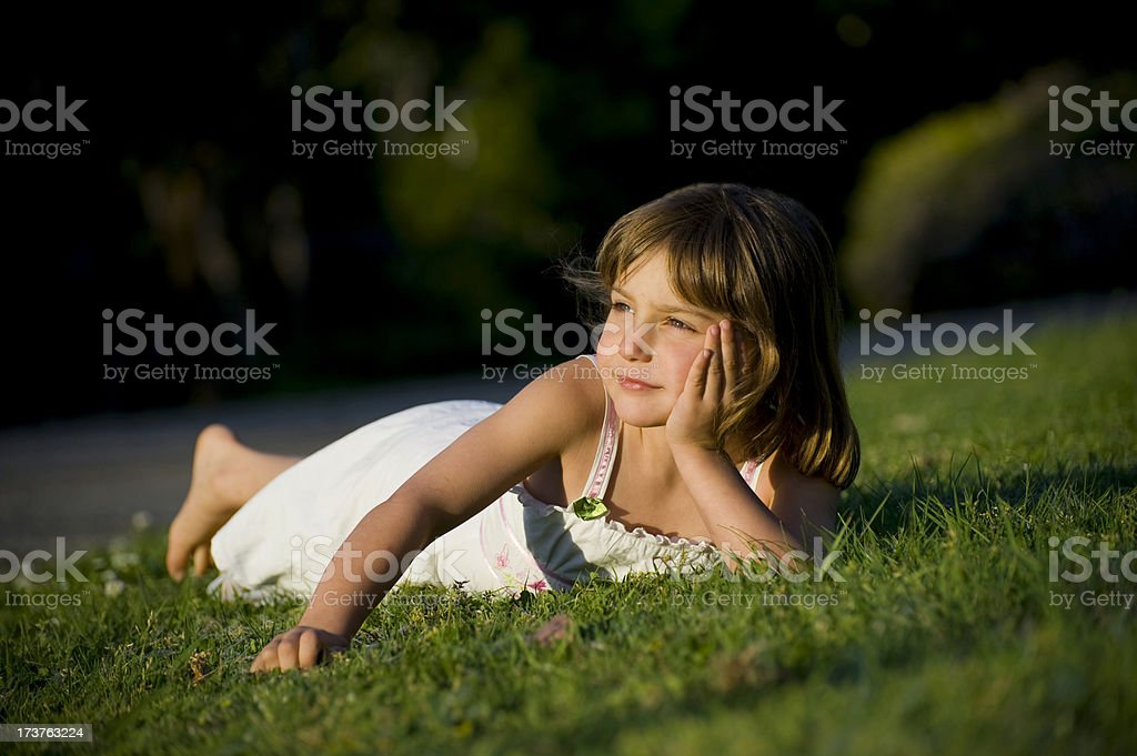 Small Child Lying on Grass royalty-free stock photo