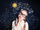 istock Small child mathematics student thinking on background with lightbulb and math formulas. Kid ideas 1019220322