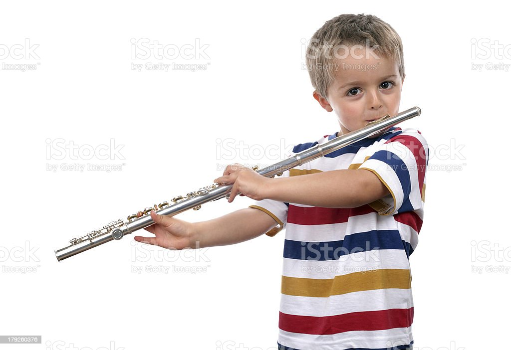 Small child playing a large flute royalty-free stock photo
