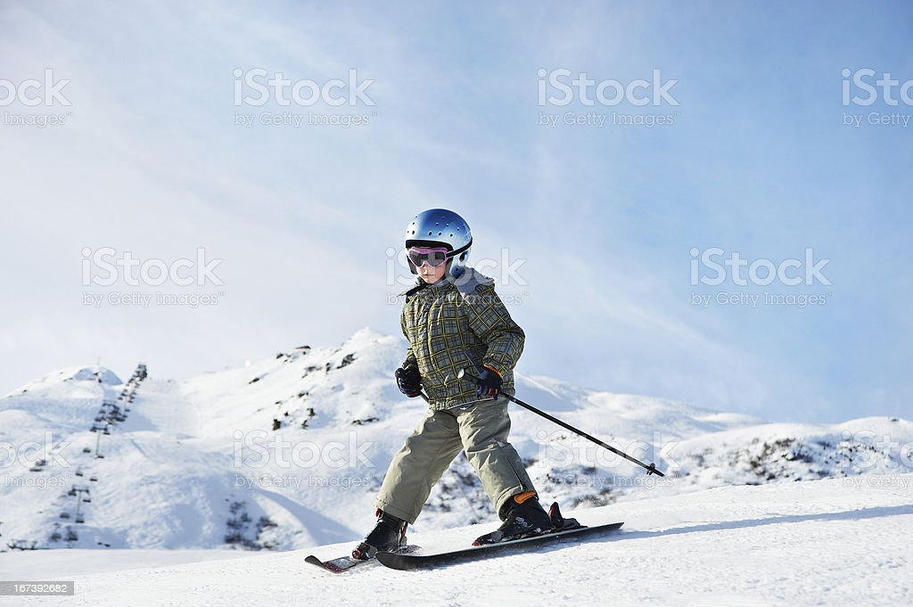 Small child skiing on snow slope stock photo