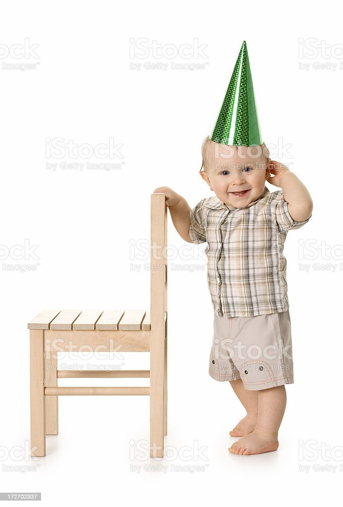 small child standing in a party cap royalty-free stock photo