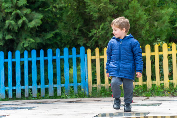 Small child walking and looking at his feet stock photo