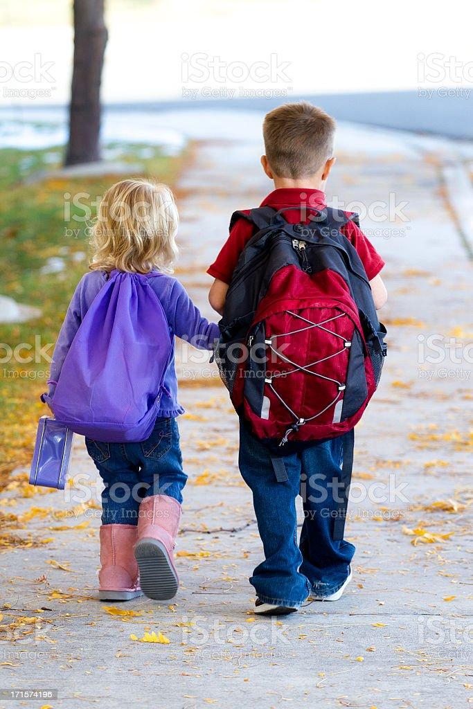 Small children walking to school stock photo