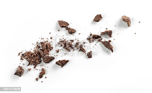 small chocolate crumbs isolated on white background, top view