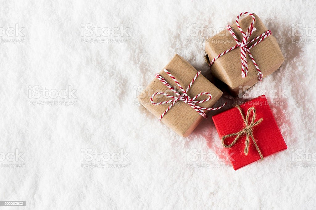 Small Christmas homemade gifts Small Christmas homemade gifts over snow surface. Art And Craft Stock Photo