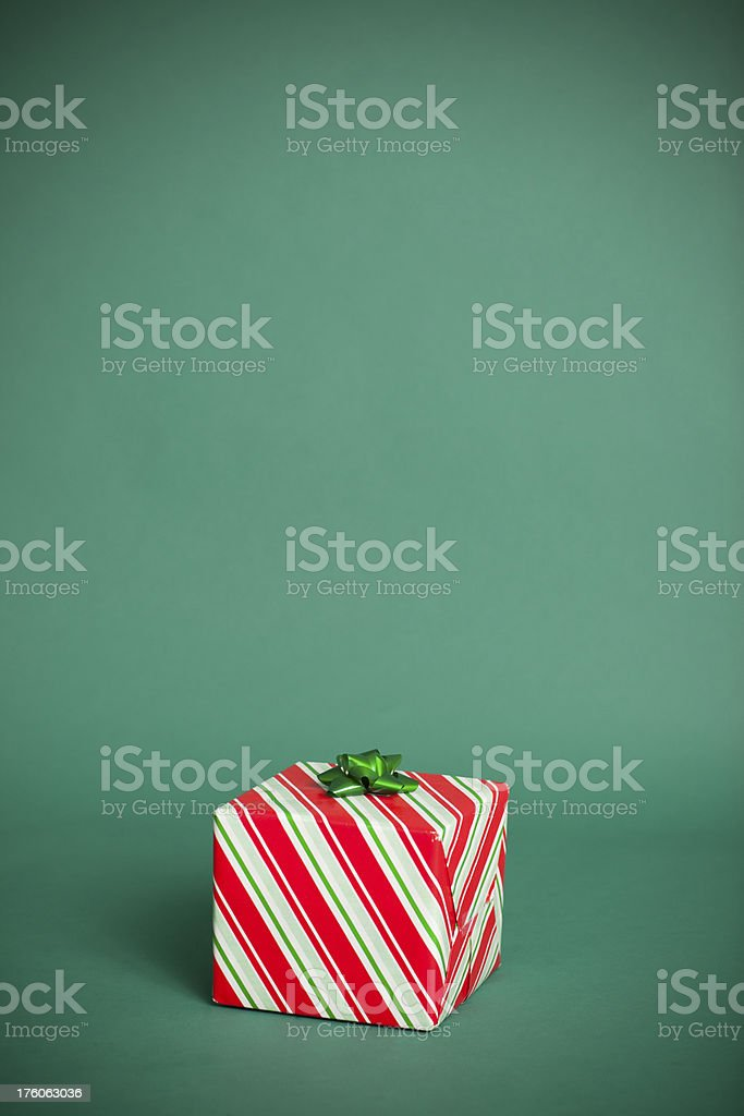 Small Christmas Present on Green Background stock photo