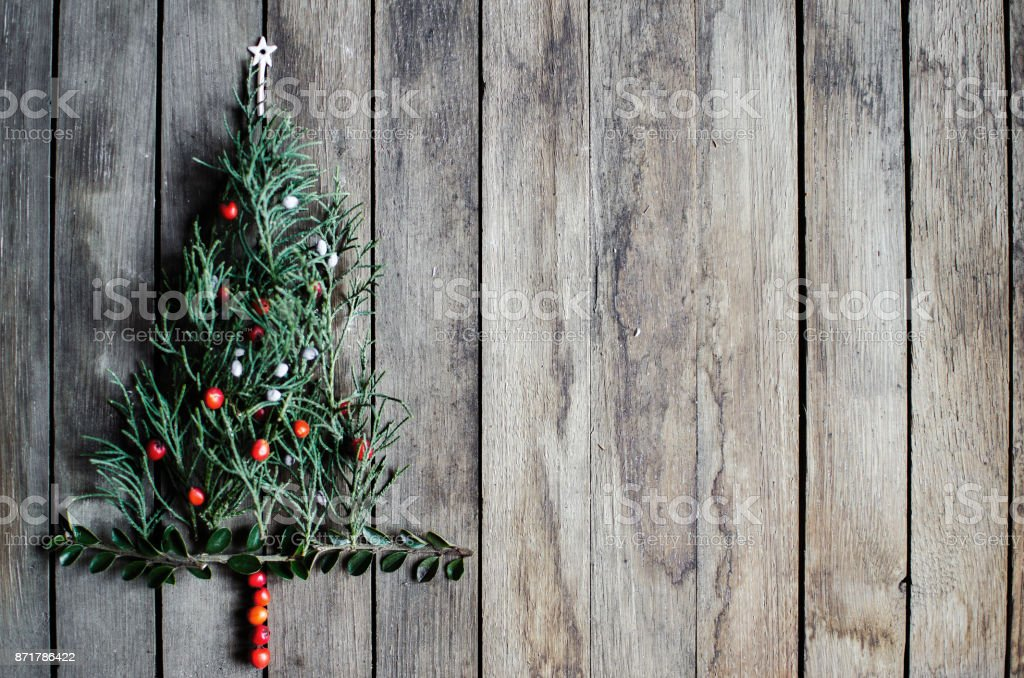 Small Christmas tree with colored berries stock photo