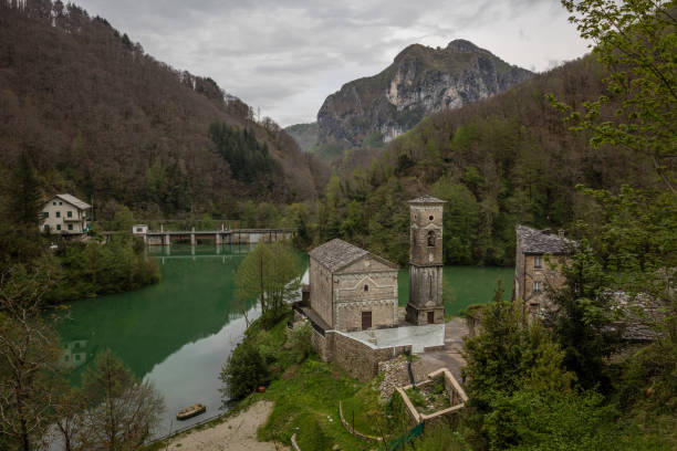 Small church at a pond between Toscany hills stock photo
