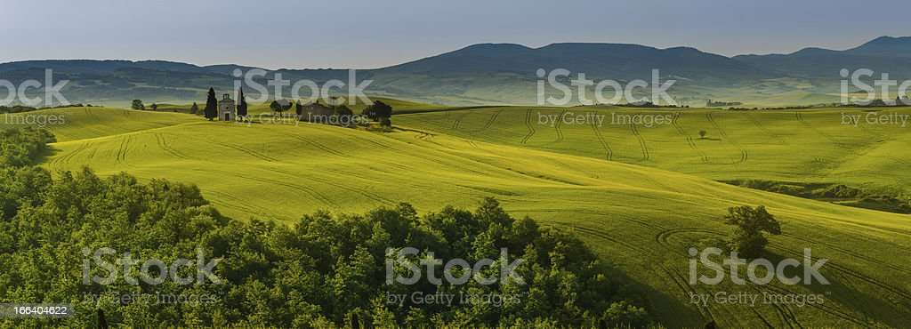 small church in green fields of tuscany royalty-free stock photo
