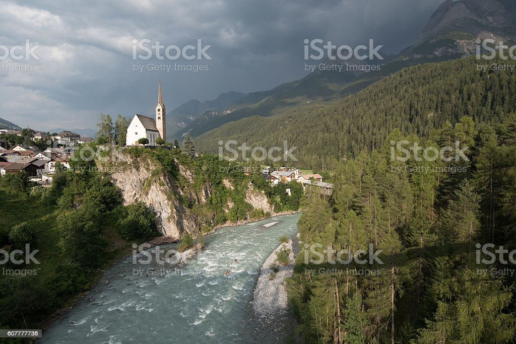 Small church in mountains Alps stock photo