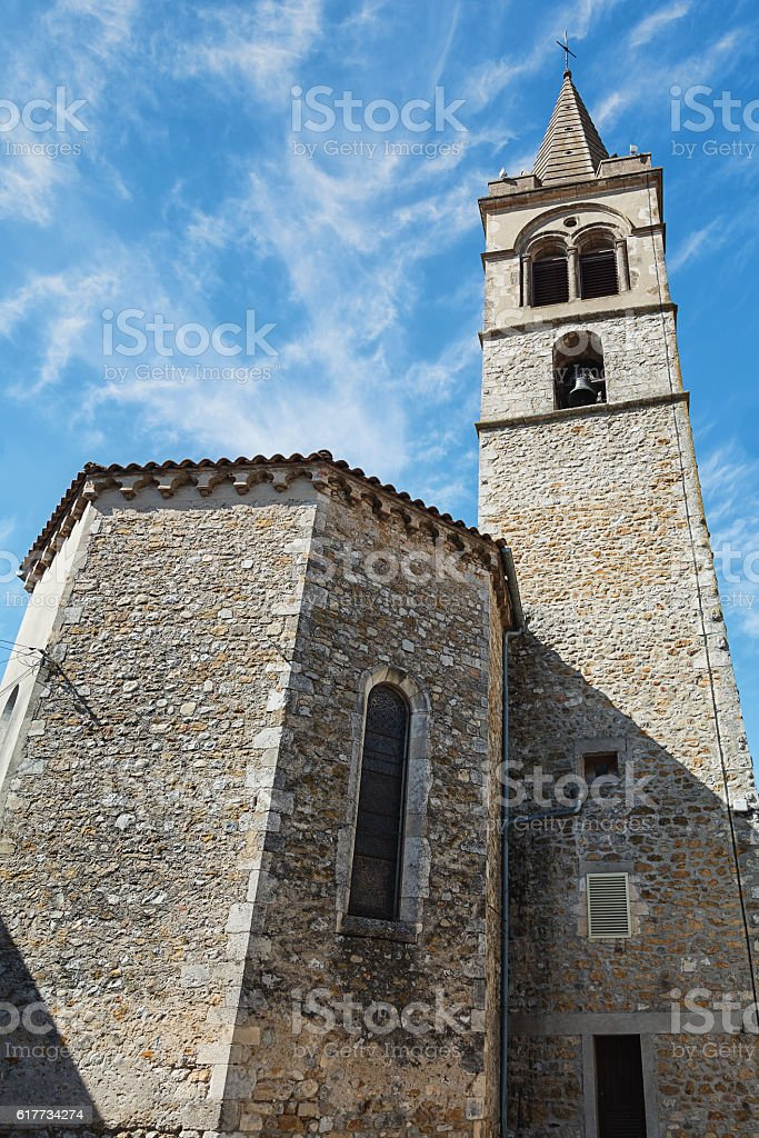 Small church in the French town. stock photo