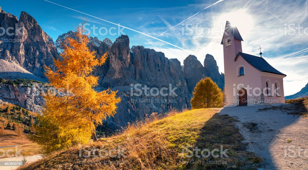 Small church on the top of Gardena pass with Piz Boe mountain on background. stock photo