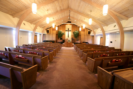Sanctuary of a small church with pews and pulpit