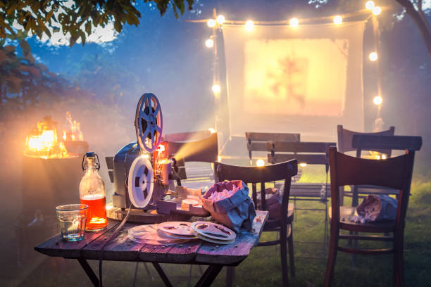Small cinema in the summer garden in the evening stock photo