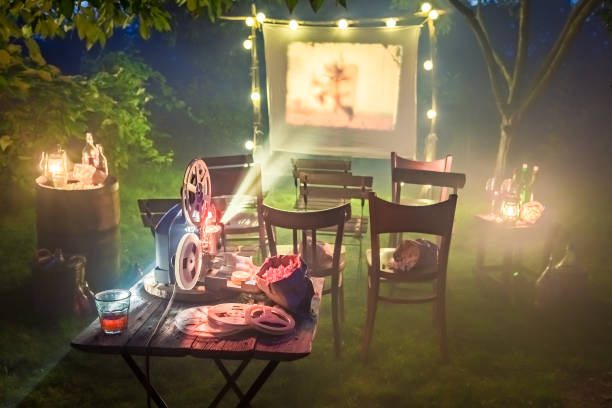 small cinema with retro projector in the garden - film festival stock photos and pictures