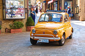 Small city car Fiat 500 on the street in Italy