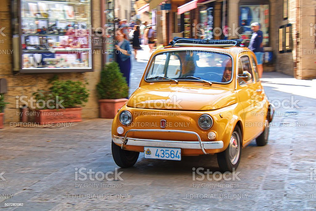 Small city car Fiat 500 on the street in Italy stock photo