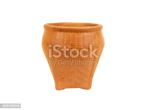 istock Small clay pot in weave wooden style isolated on white 626265538