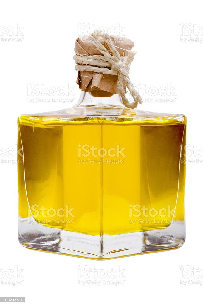 Small closed bottle with yellow oil inside royalty-free stock photo
