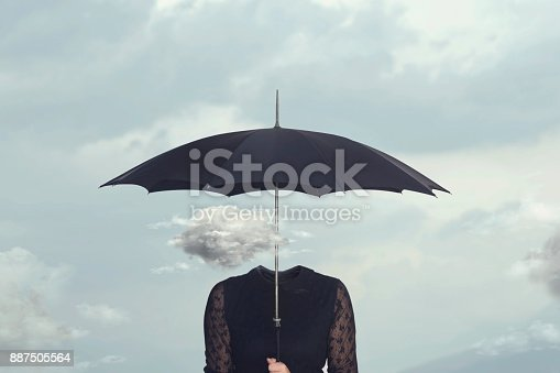 istock small cloud that repairs from the rain under the umbrella of a headless woman 887505564