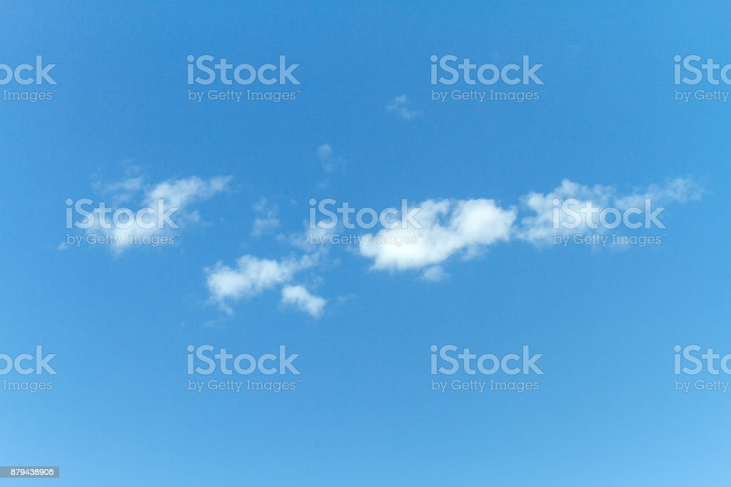 Small clouds against blue sky stock photo