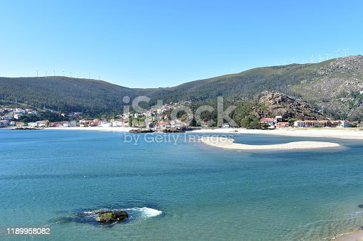 Ezaro, Dumbria, Rias Altas, A Coruña Province, Galicia Region, Spain. Fishing village with beach, mountain and forest on a sunny day.