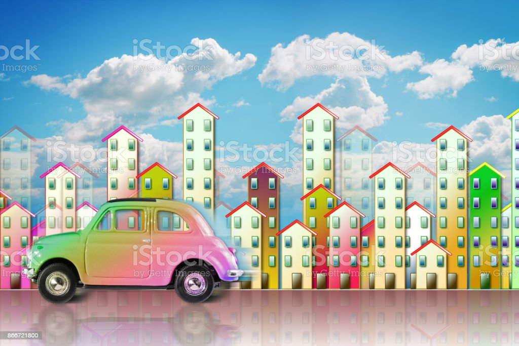Small colored utilitarian car in a big city - concept image with copy space stock photo