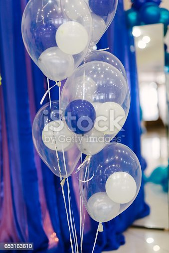 istock Small colorful balloons on a blue background 653163610