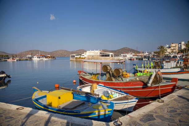 Small colorful fishing boats in the port. The harbor of Elunda in Crete, Greece. – zdjęcie