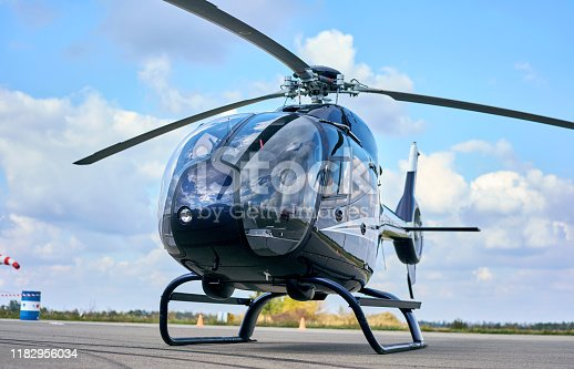 istock small commercial helicopter at the airport 1182956034
