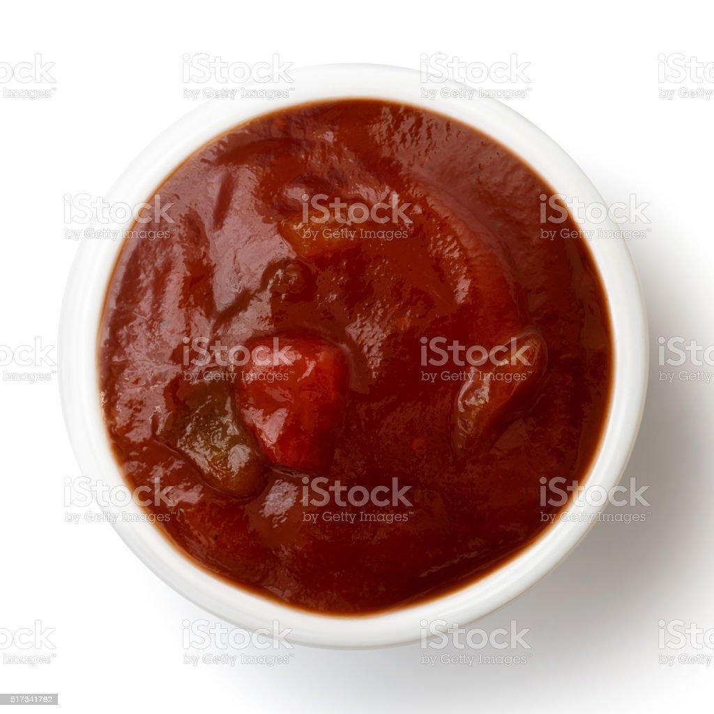 Small condiment bowl of  tomato and red chilli pepper salsa. stock photo