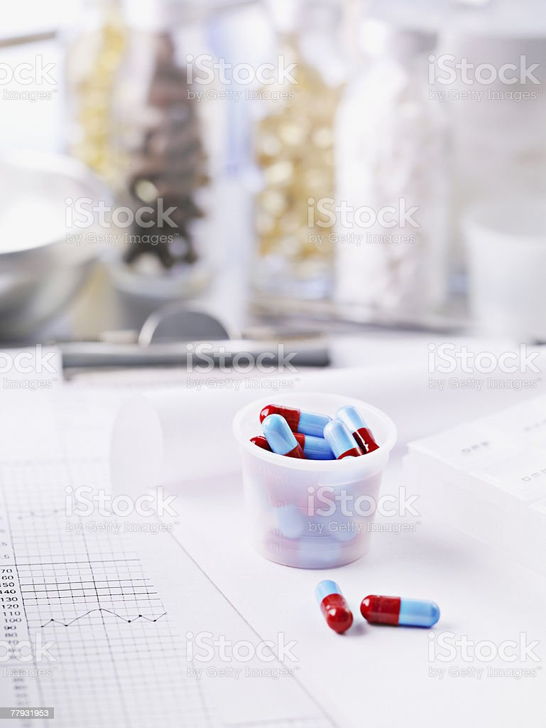 Small container filled with pills royalty-free stock photo