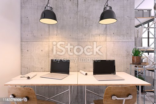 Small contemporary office interior with chairs and large office desk with blank laptop screens for copy space and big blank concrete wall in the background. Render.