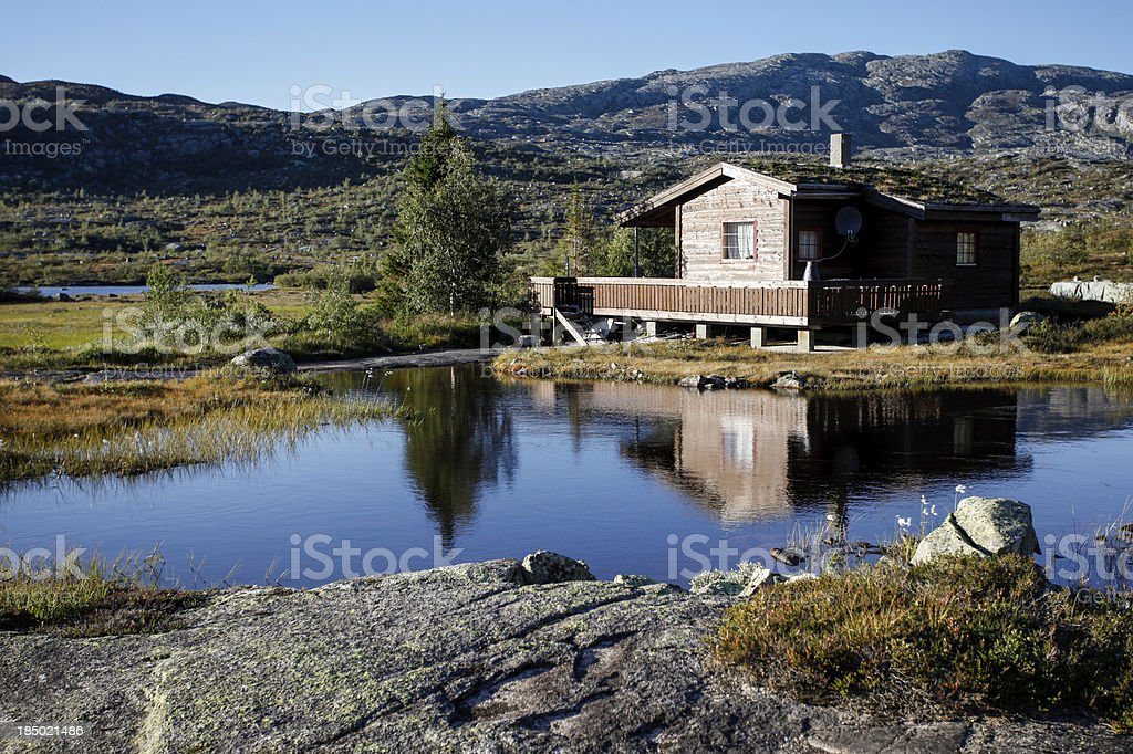 small cottage at norwegian lake stock photo