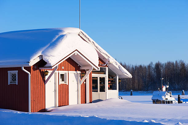 Small cottage in winter stock photo